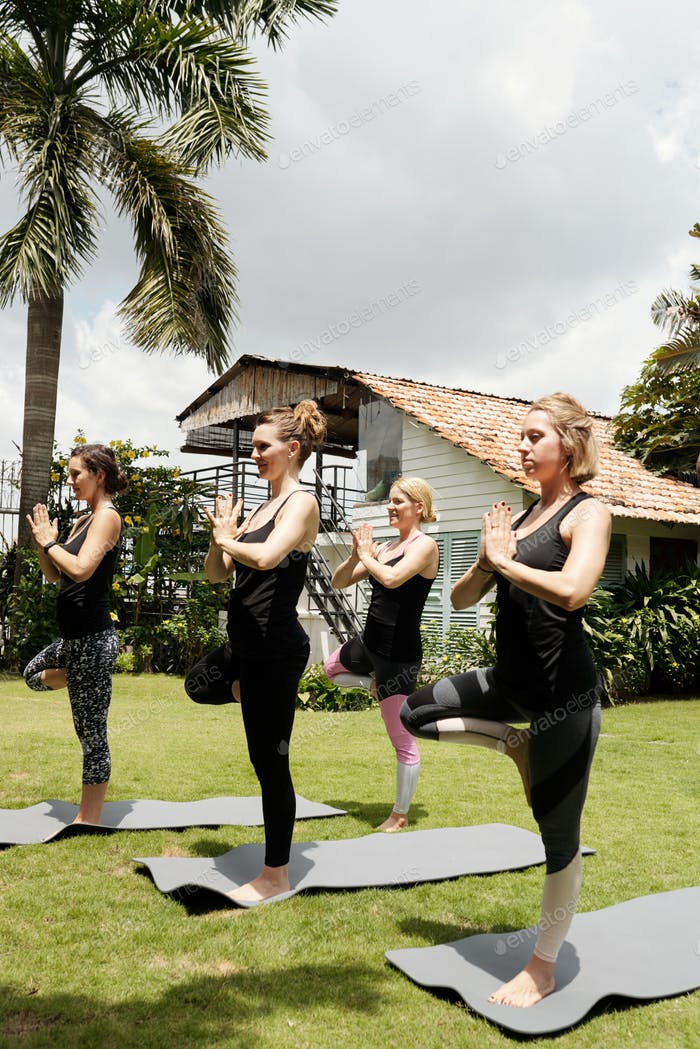 Women Practicing Tree Yoga Pose