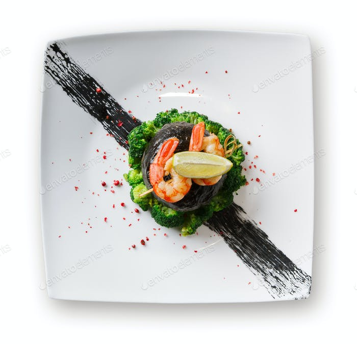 Dorado fillet in nori with shrimps isolated