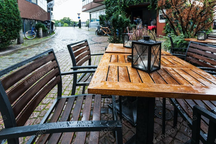 empty wooden wet table in outdoor cafe