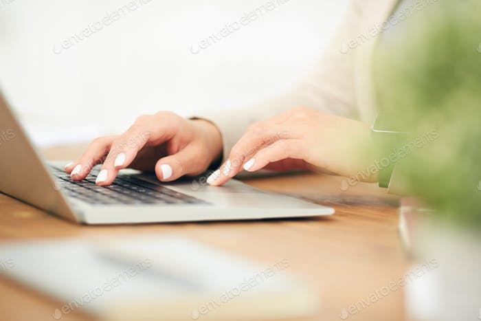 Businesswoman Using Laptop Close Up