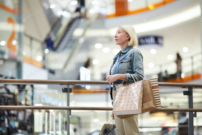 Lost woman in big shopping mall