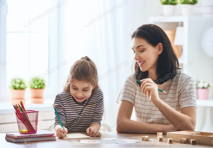 woman teaches child the alphabet