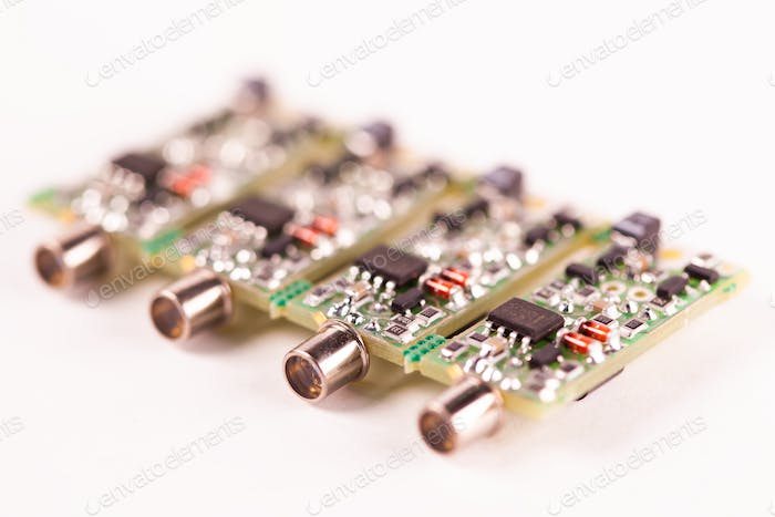 Close-up of four small microcircuits PCB