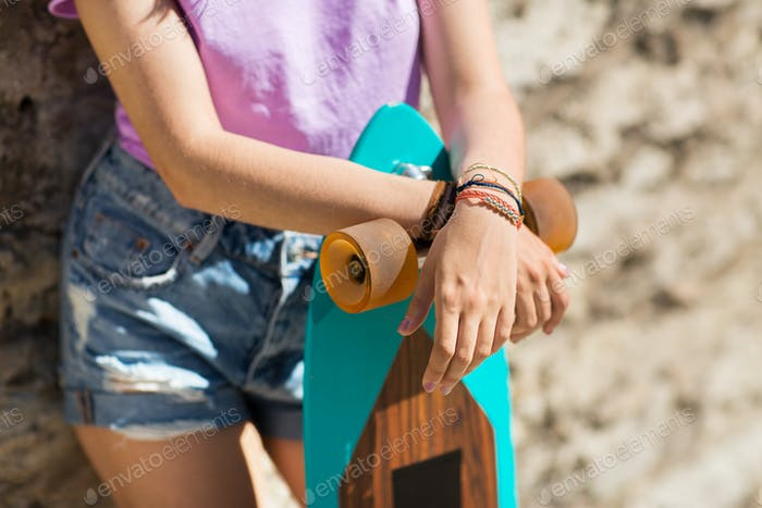 close up of teenage girl with longboard