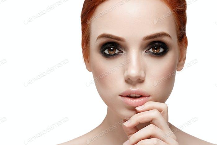 Amazing make up woman face close up portrait isolated on white Beautiful big eyes