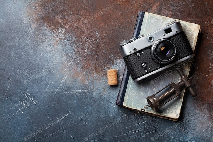 Vintage camera and wine corkscrew