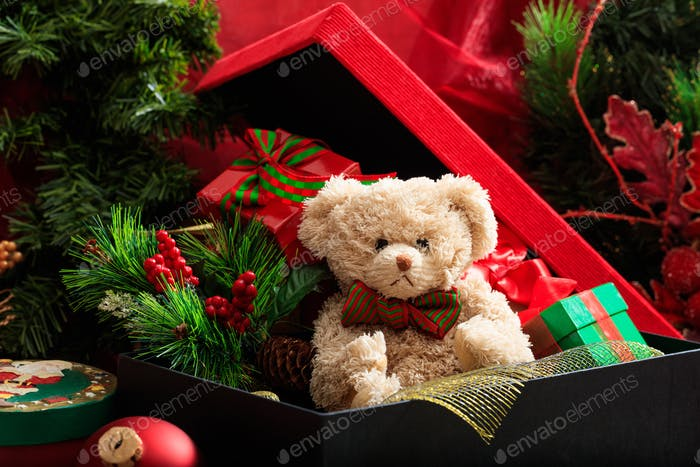 Christmas balls, teddy bear and gifts