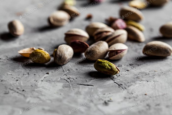 Big set of salted pistachios on the table. Pistachios nuts