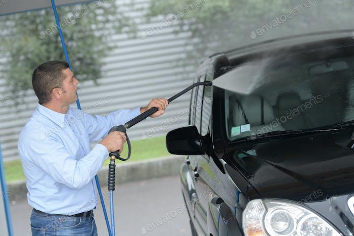 Man power washing vehicle
