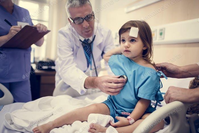 Sick little girl in a hospital