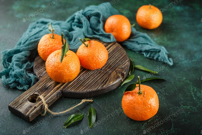 Tangerines oranges, mandarins, clementines, citrus fruits with leaves