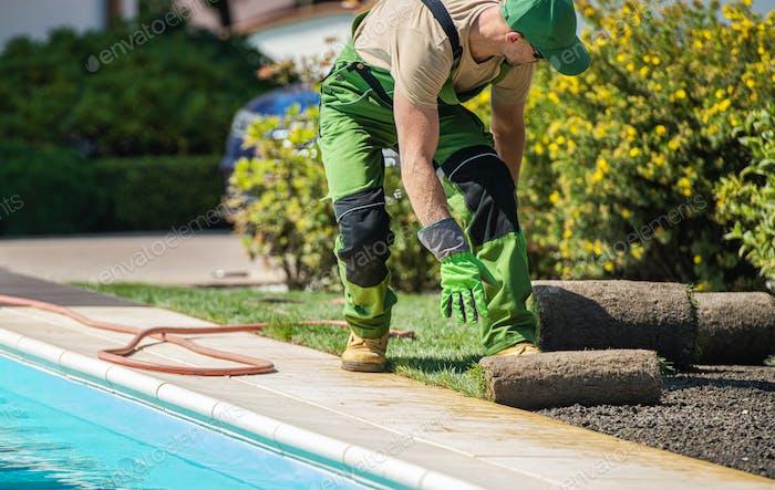 Professional Gardener Working Next to Outdoor Pool