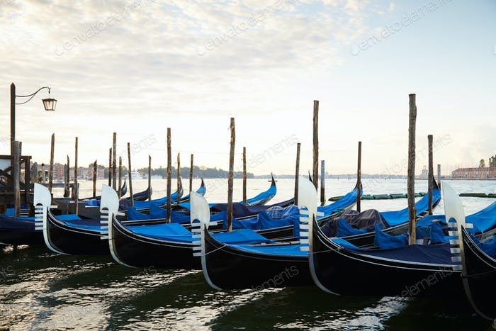 Gondola boats moored in Grand Canal in Venice, nobody