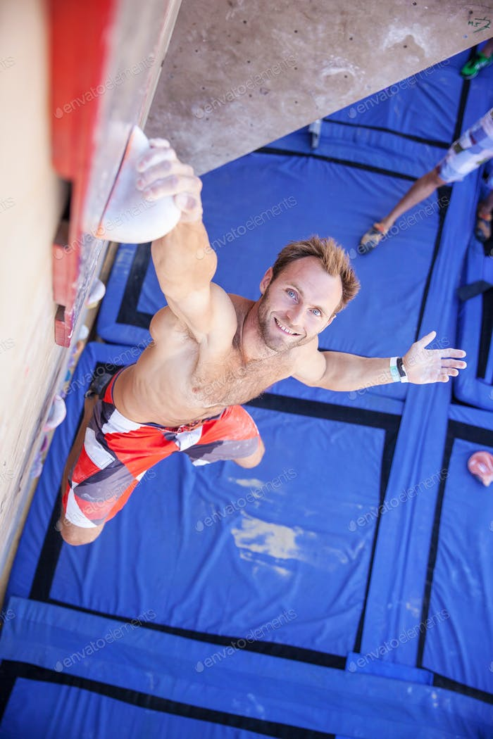 """Rock climber participating in climbing competition"