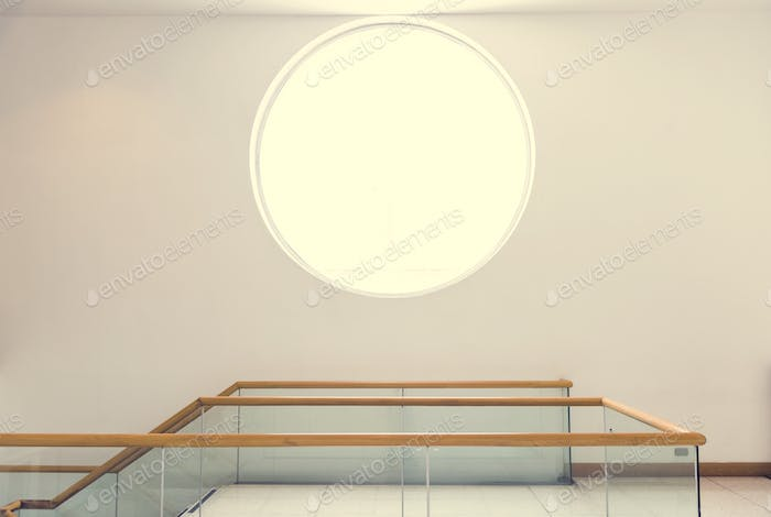 Round window on a white wall