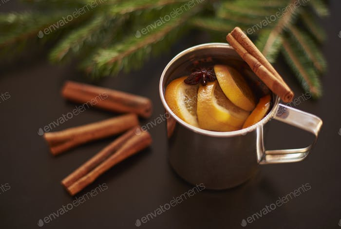 Warming up by drinking mulled wine