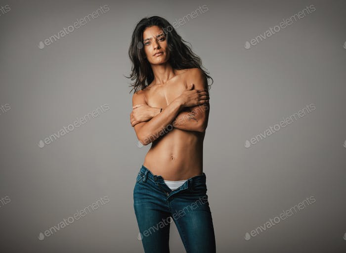 Beautiful topless woman stares at camera