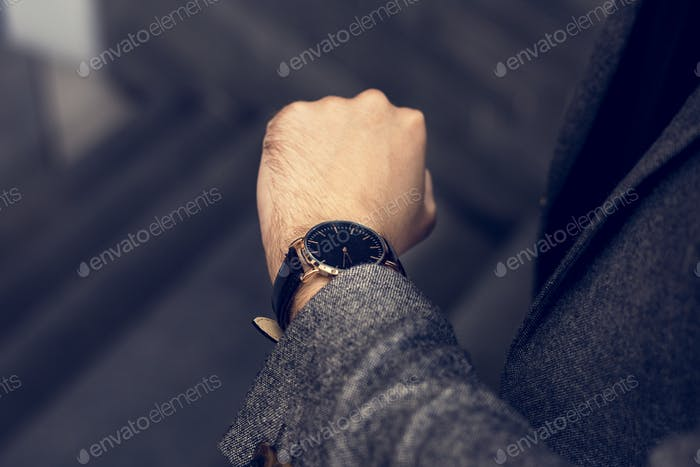 Man looking at his watch