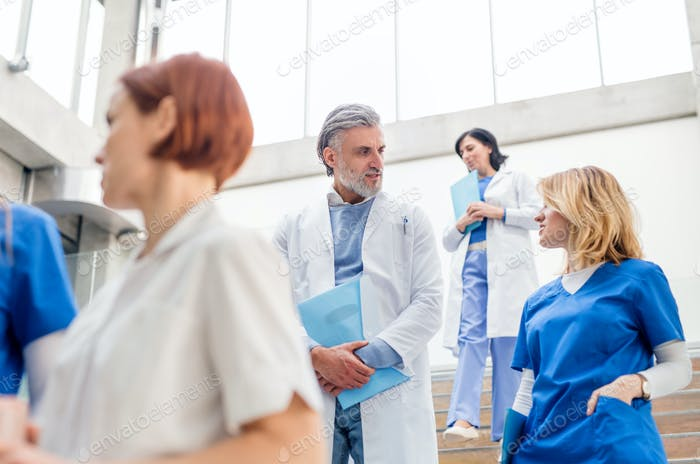 Group of doctors walking down stairs on medical conference