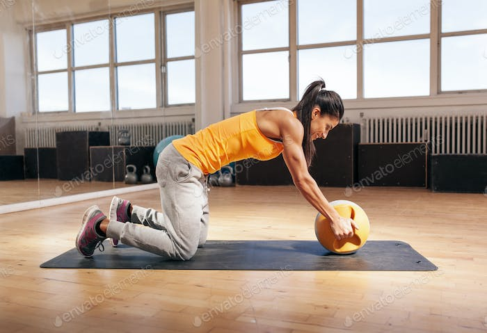 Thumbnail for Young woman exercising with kettle bell