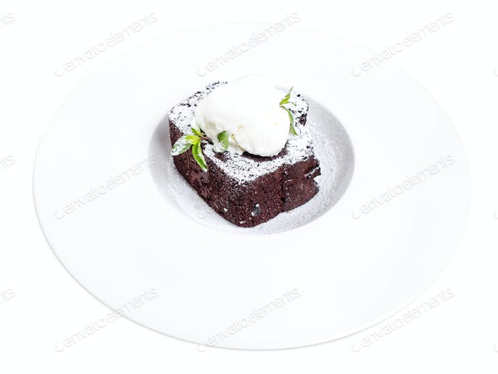 Chocolate brownie cake with vanilla ice cream.