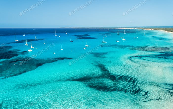 Aerial view of boats and luxury yachts in transparent sea