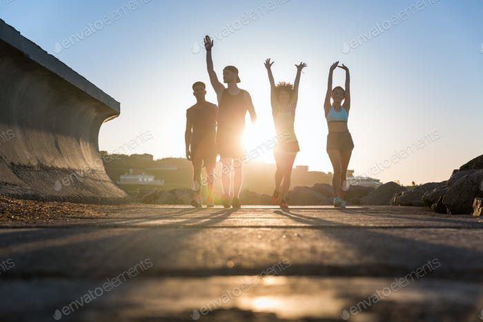 Group of runners working out on a road by the sea
