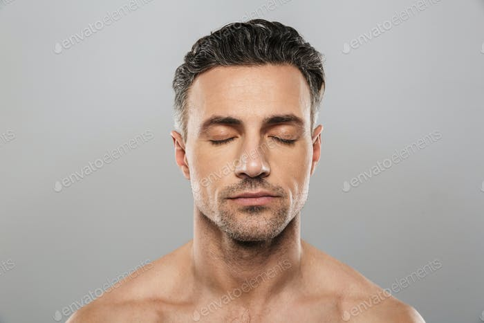 Handsome concentrated mature man. Eyes closed.
