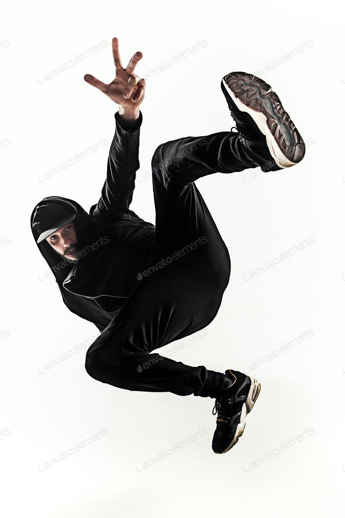 aa3f29bfc31 The silhouette of one hip hop male break dancer dancing on white background