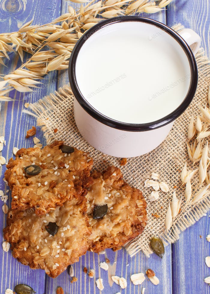 Oatmeal cookies, ingredients for baking and ears of oat, healthy dessert concept
