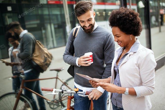 Business people on coffee break using digital tablet outdoor