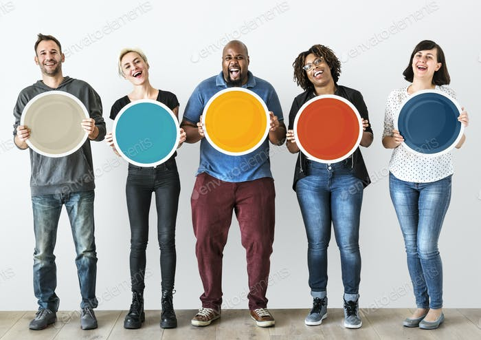 Diverse people holding blank round board