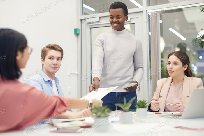 African-American Man Leading Business Meeting