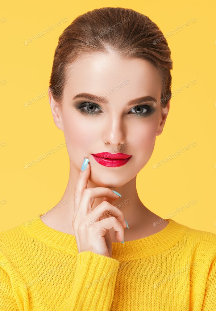 Colorful makeup woman in yellow clothes on color summer background Red Lips
