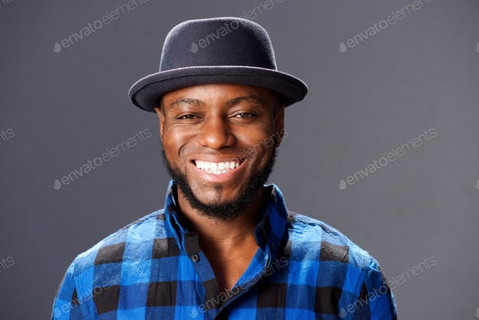 african man smiling with hat and plaid shirt