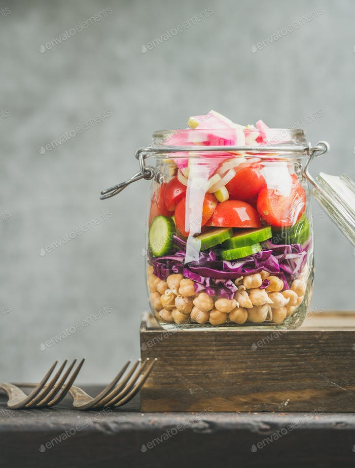 Close-up of Healthy layered take-away salad with vegetables, chickpea sprouts