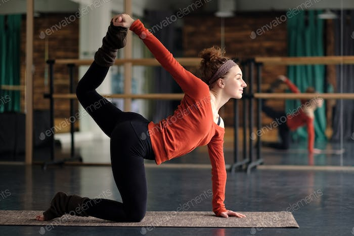 woman practicing yoga, stretching in cat exercise, tiger pose
