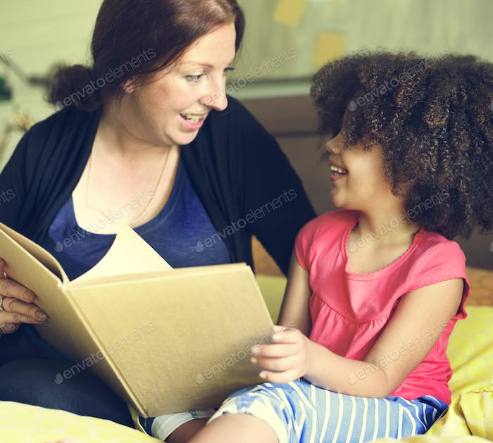 Reading Mother Daughter Reading Story Book Concept