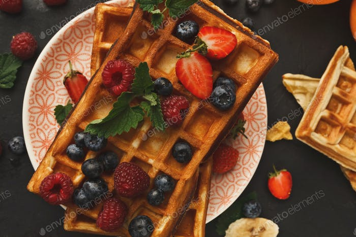 Belgian waffles with berries and fruits