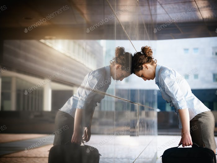 Sad Business Woman Banging Head Against Wall