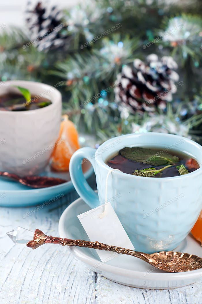 two tea cups with teabag and xmas tree