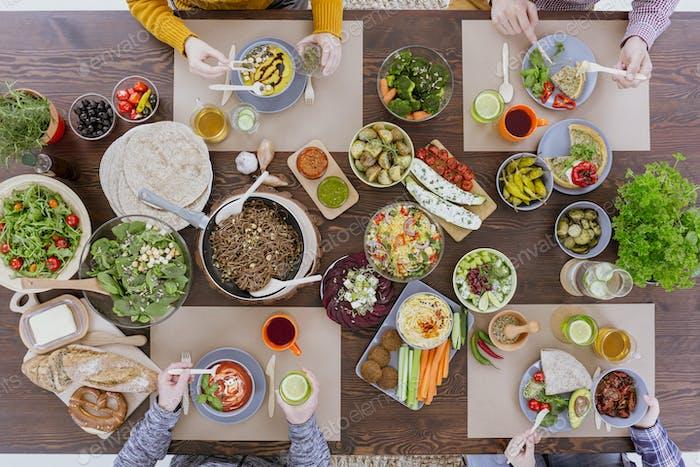 Friends eating vegetarian food