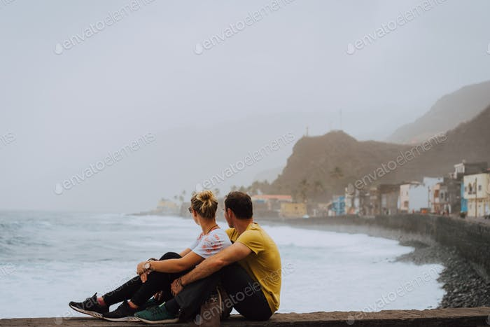 Santo Antao Island, Cape Verde. Couple in front of coastal town of Paul enjoying atlantic ocean