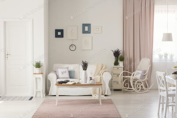 Wooden Table On Pink Rug In White Living Room Interior With Rock Photo By Bialasiewicz Envato Elements