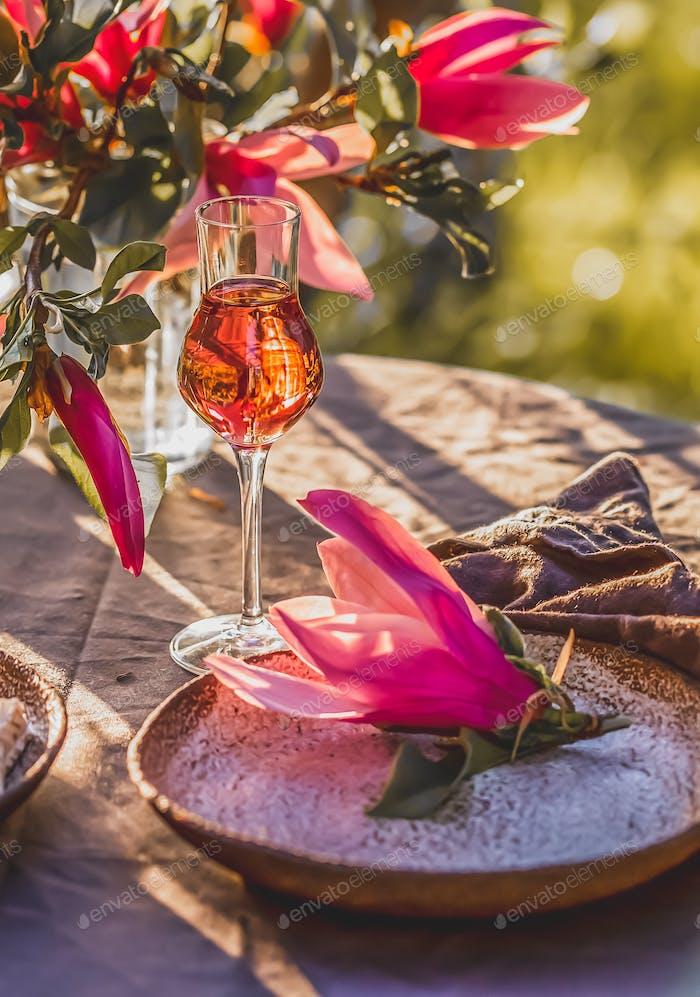 Beautiful table setting in garden on sunset light.