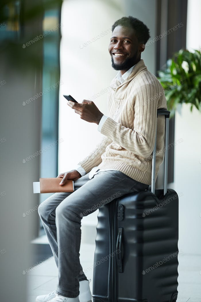 Traveler on suitcase