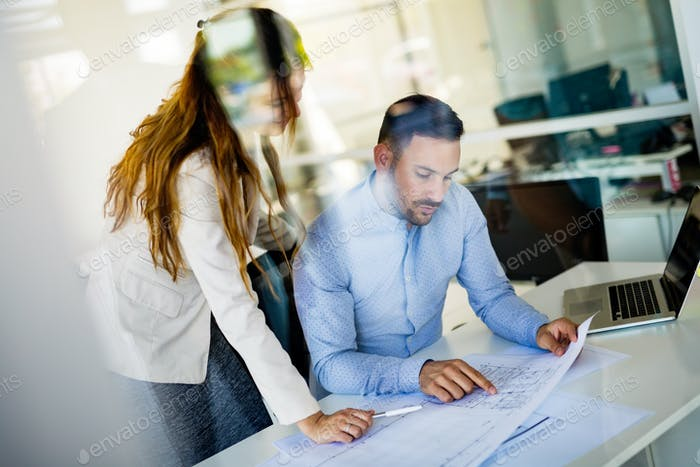 Picture of handsome man and woman as business partners