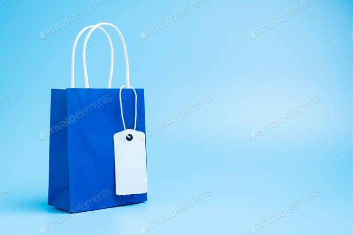 Blue shopping or gift bag isolated on blue background