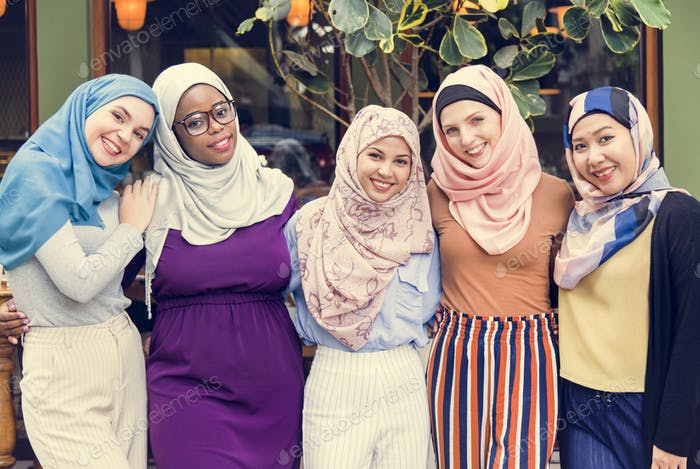 Group of islamic friends arms around and smiling together