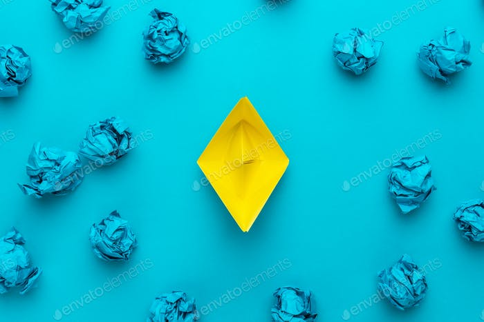 Great Idea Concept With Crumpled Office Paper And Yellow Paper Ship